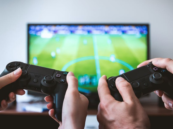 man and woman hands playing a video game